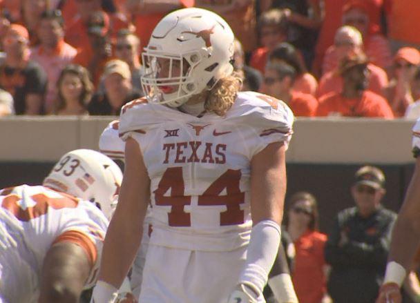 Texas defensive end Breckyn Hager, hillbillies drinking moonshine