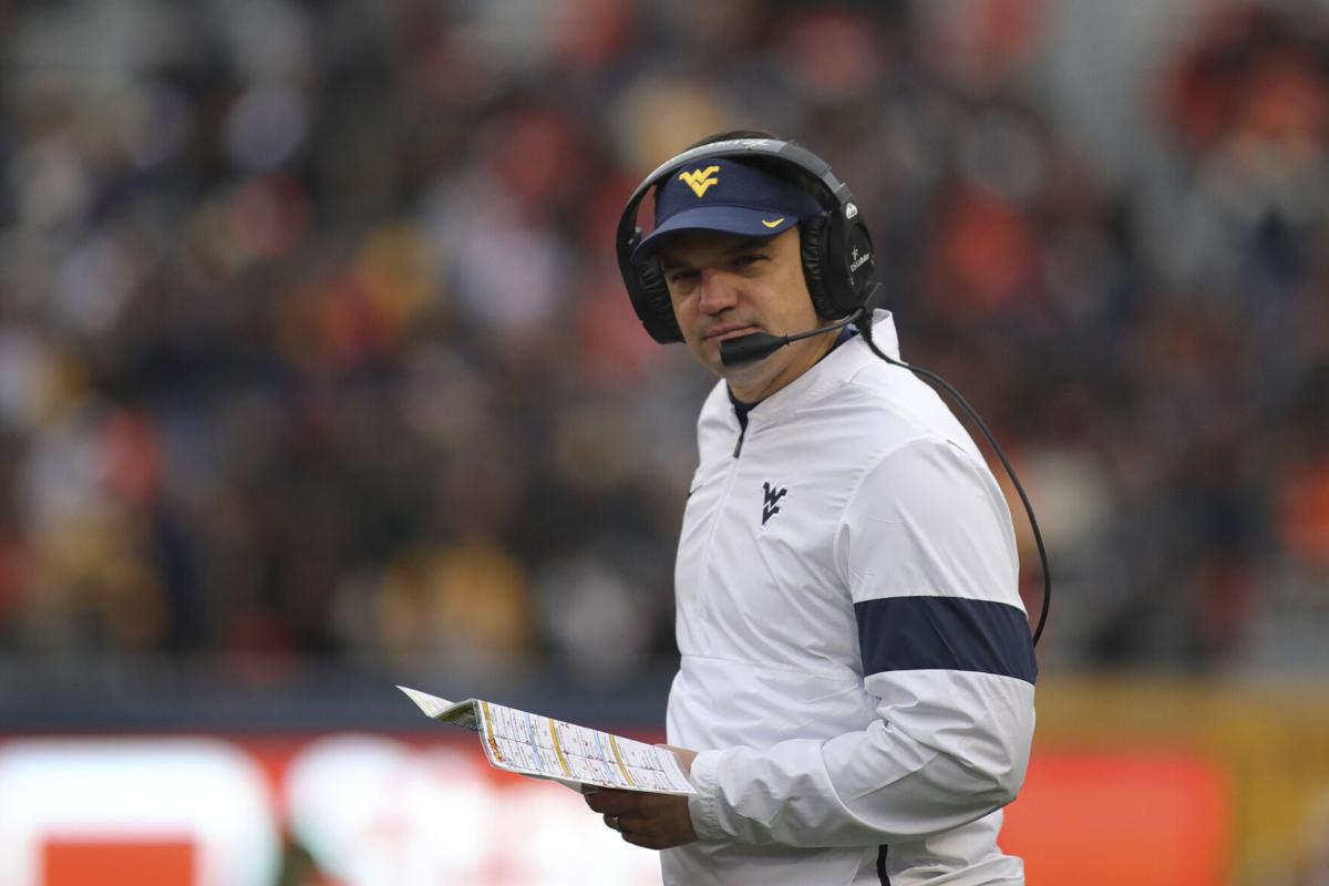 wvu suspends 11 players